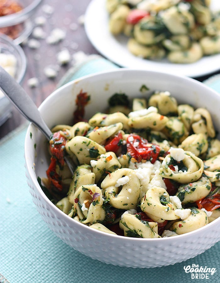 This tortellini sauce has a some Latin American flair. Tomatillos are roasted with garlic and olive oil, blended with fresh spinach and roasted tomatoes, then tossed with queso fresco cheese.