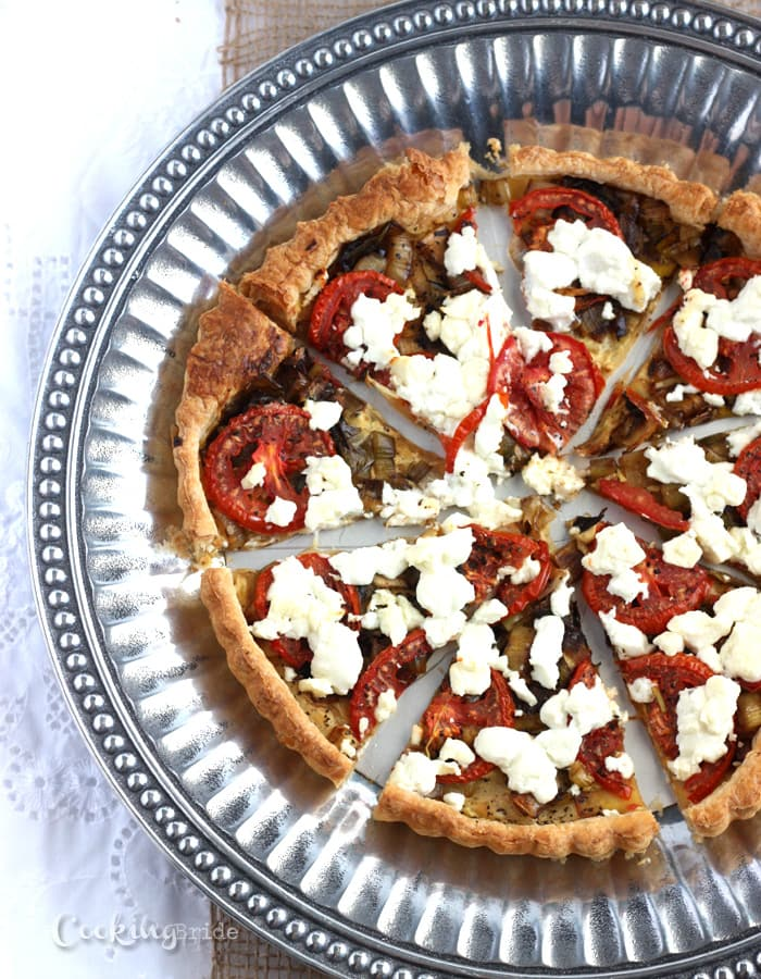 Creamy goat cheese, ripe roma tomatoes, and flaky puffed pastry are a winning combination in this savory tart recipe. Perfect for brunch or a light dinner.