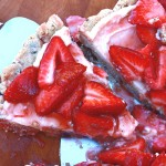 This elegant strawberry dessert pizza has a chocolate chip shortbread crust, topped with sweetened marcapone cheese and glazed strawberries.