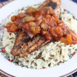 This simple and delicious Creole inspired blackened catfish recipe is seasoned with homemade spice rub then topped with a savory tomato sauce.