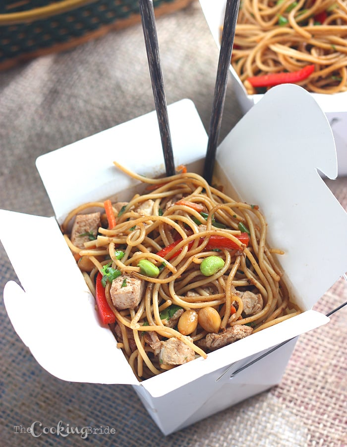 Asian noodle salad in a white Chinese take out box with chop sticks