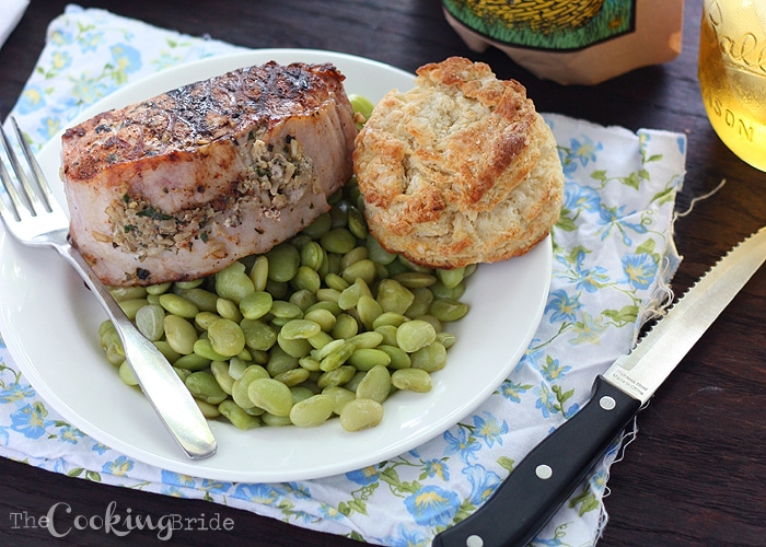 Thick grilled boneless pork loin chops are stuffed with a creamy brown rice mixture seasoned with homemade fresh herb pesto.