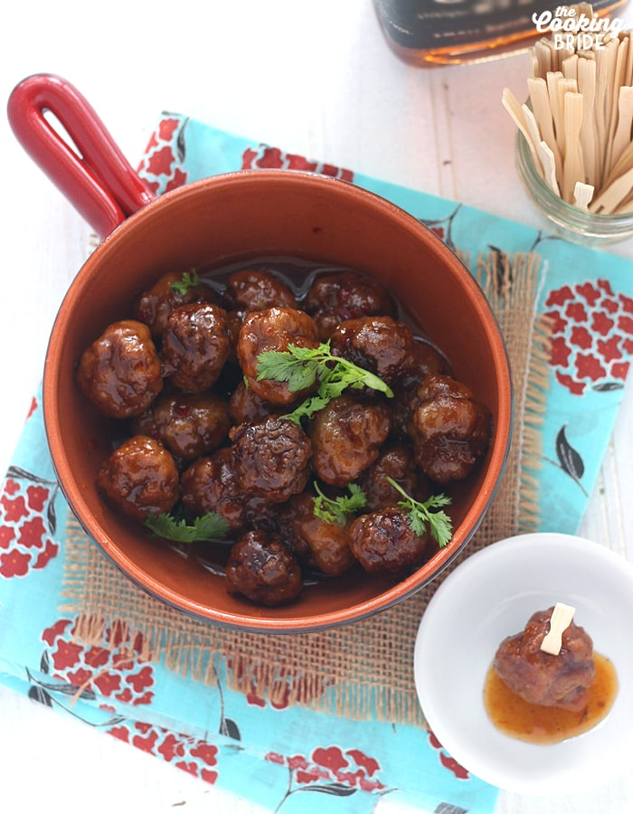 This chicken meatball recipe is the perfect appetizer! It's glazed in a sweet and sour mixture of bourbon, apricot preserves, mustard, and chili garlic sauce.