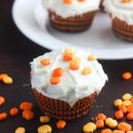 Easy pumpkin spice cupcakes have a sweet Nutella center.