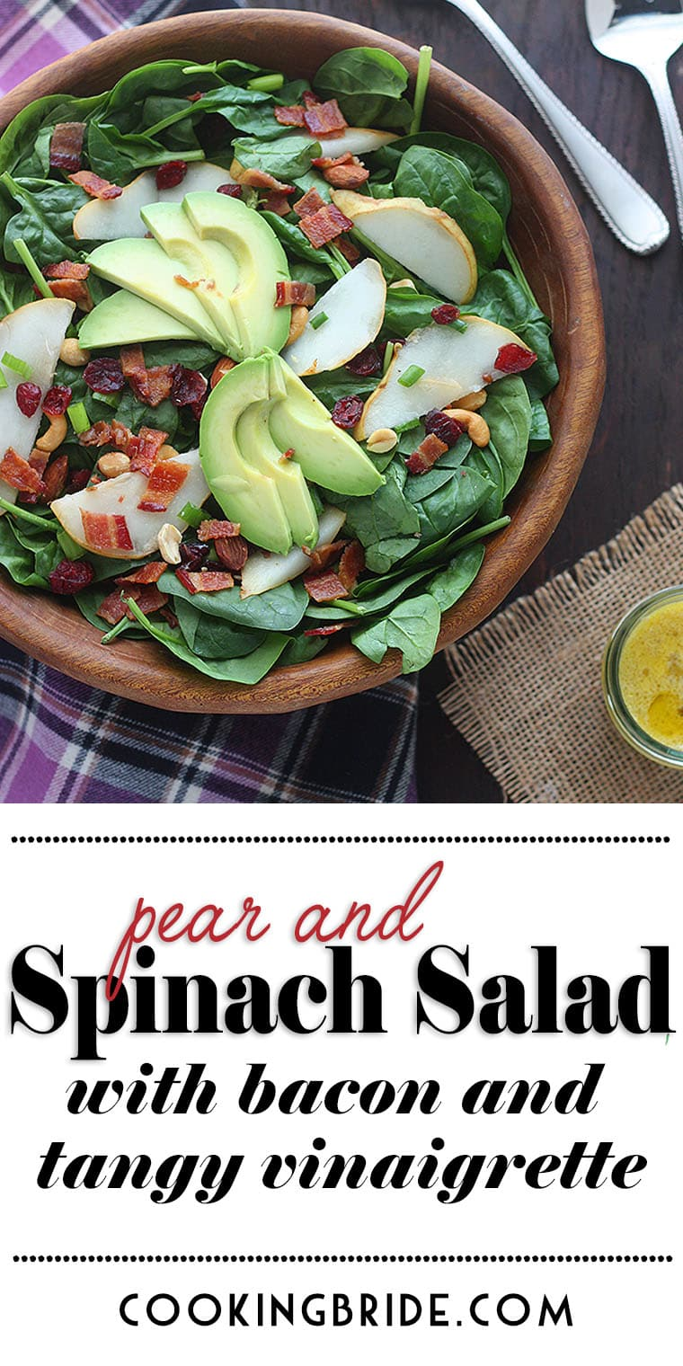 Spinach pear salad with dried cranberries and bacon is satisfying enough to serve on its own as a meal or as a side salad.
