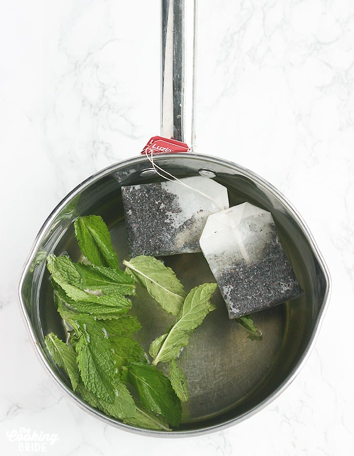saucepan with tea bags, water and mint