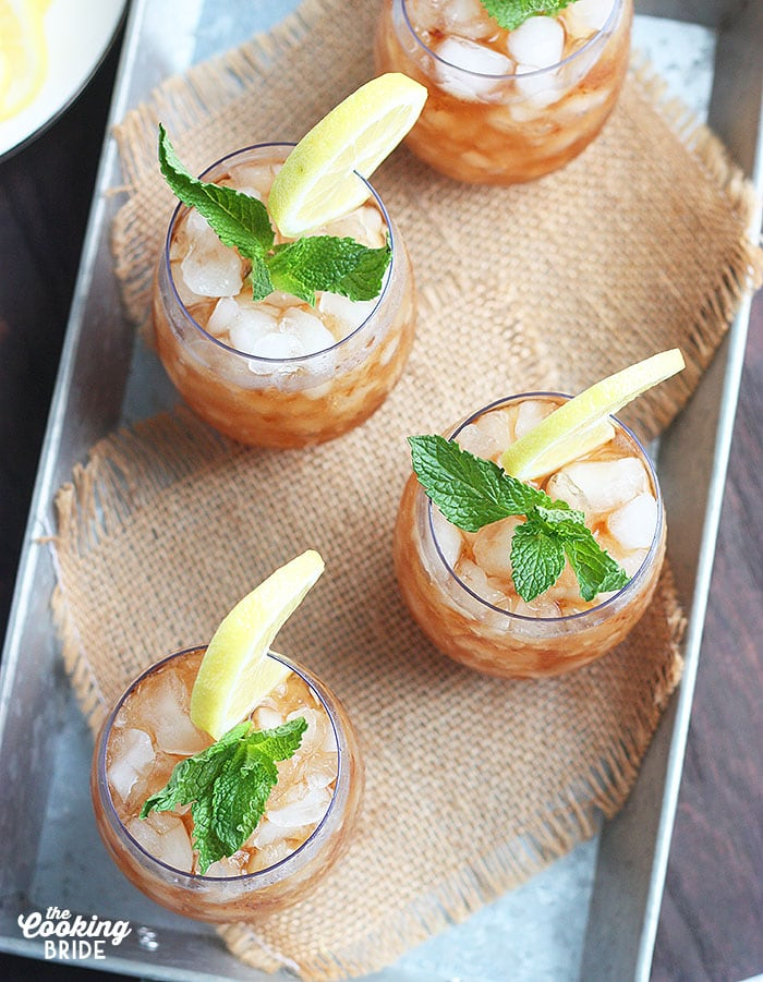 four sweet tea mint julep cocktails on a metal tray