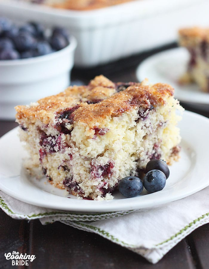 square of blueberry breakfast cake on a white plate