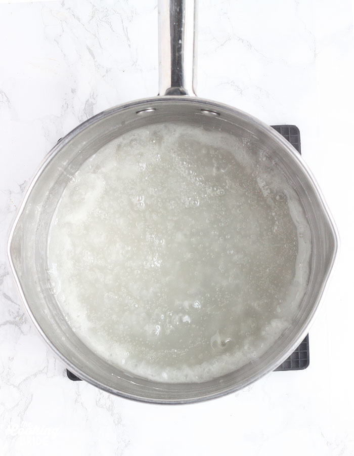 sugar and cornstarch in a metal saucepan after it has started to thicken
